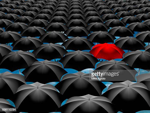 single red umbrella - mike agliolo stock pictures, royalty-free photos & images