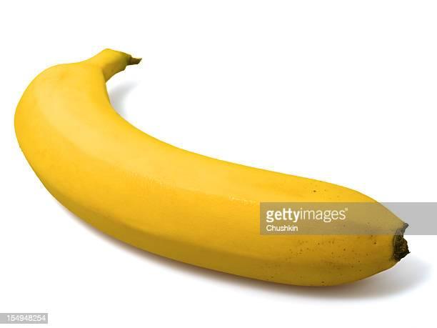 A single ripe banana on a white background