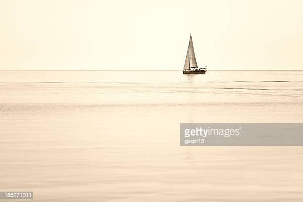 single sailboat on horizon