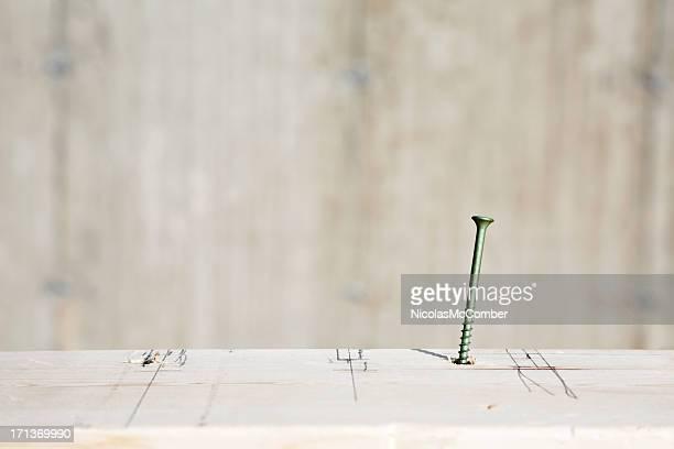 Eine Schraube in plank mit Bau Zeichnung