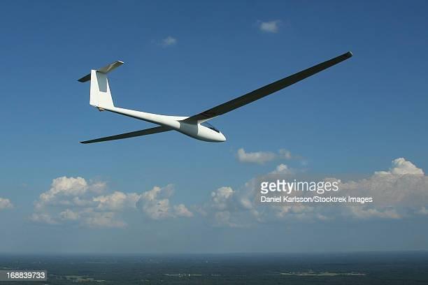 A single seaterÊRolladen-Schneider LS4 glider soars over Herrljunga, Sweden.
