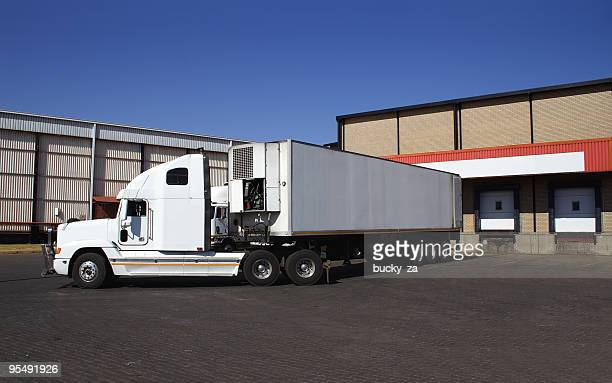 single semi truck at frozen goods warehouse - loading dock stock pictures, royalty-free photos & images