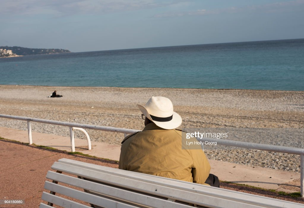 Single senior man on bench by the sea : Stock Photo