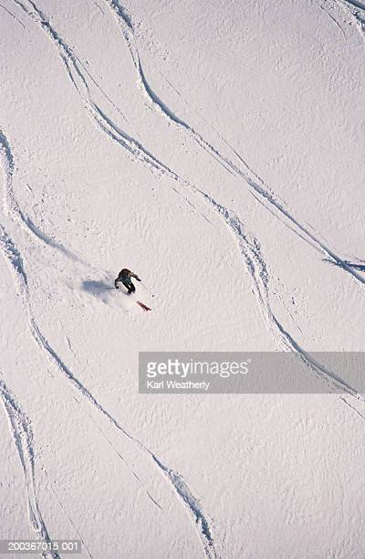 Single skier surrounded by serpentine tracks, Idaho, USA, overhead view