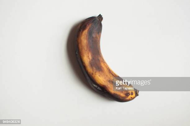 a single spoiled banana - rot stock pictures, royalty-free photos & images