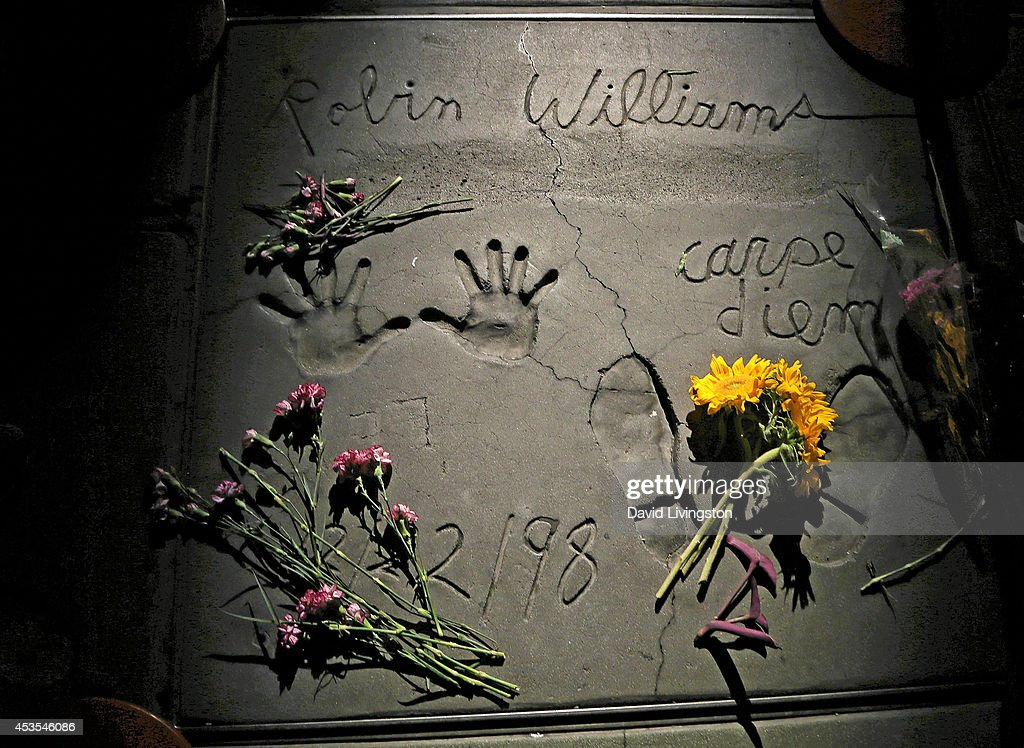 A single spotlight shines on the hand and footprints of actor Robin Williams during a ceremony to honor him at the TCL Chinese Theatre on August 12, 2014 in Los Angeles, California.