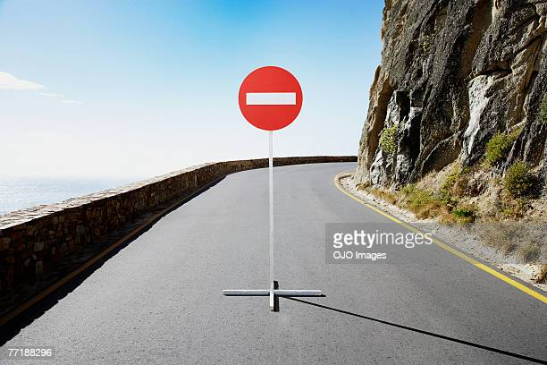 A single street sign on a desolate road