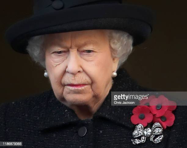 A single tear on the cheek of Queen Elizabeth II as she attends the annual Remembrance Sunday memorial at The Cenotaph on November 10 2019 in London...