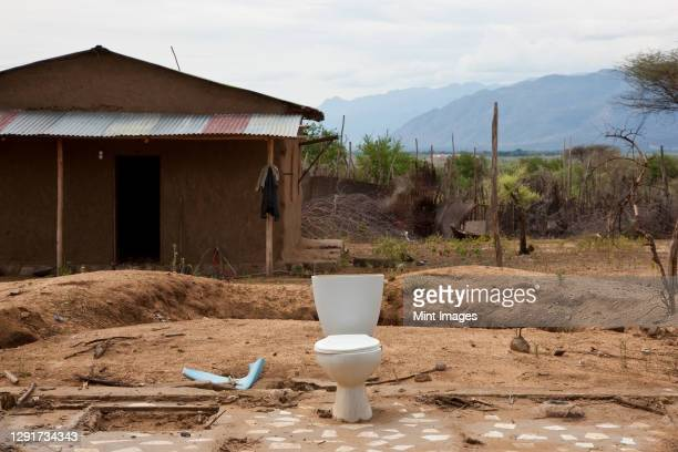 single toilet outside a derelict shack, ethiopia - horn of africa stock pictures, royalty-free photos & images