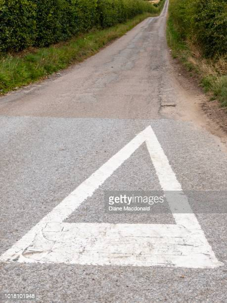 a single track road at a road junction near spey bay, moray, scotland - give way stock pictures, royalty-free photos & images