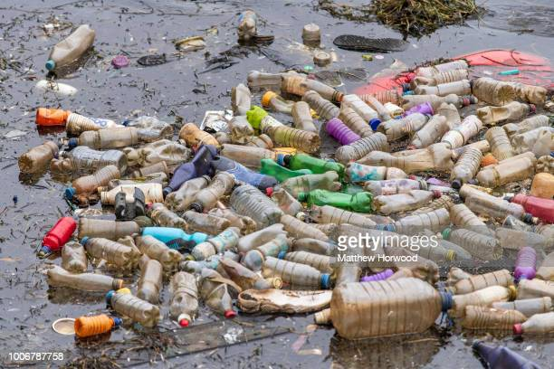 Single use plastic bottles seen floating in polluted water near Cardiff Bay on April 9, 2018 in Cardiff, United Kingdom.