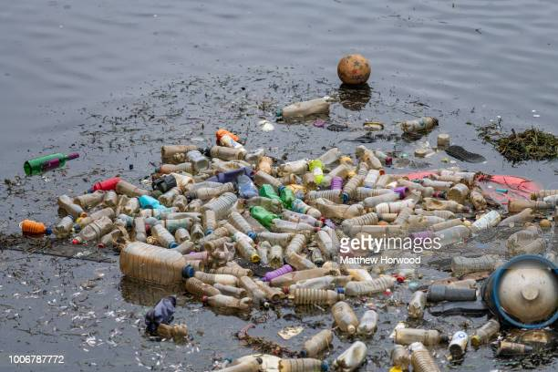 Single use plastic bottles seen floating in polluted water near Cardiff Bay on April 9 2018 in Cardiff United Kingdom