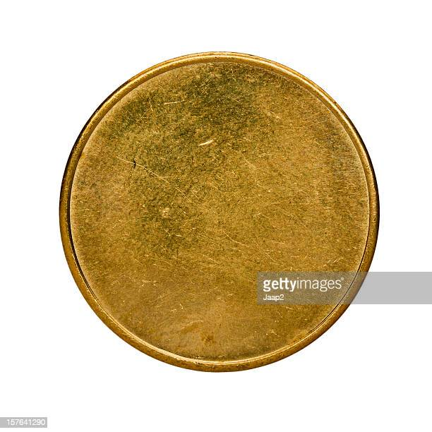 Single used blank brass coin, top view isolated on white
