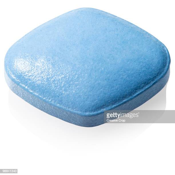 single viagra/cialis tablet - viagra stock photos and pictures