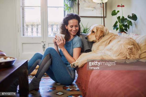 single, woman at home with technology. - yoga pants stock photos and pictures