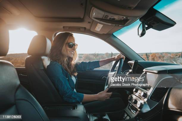 single woman driving a car - driving stock pictures, royalty-free photos & images