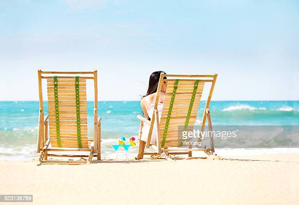 Single Woman on Beach Vacation Waiting for Partner