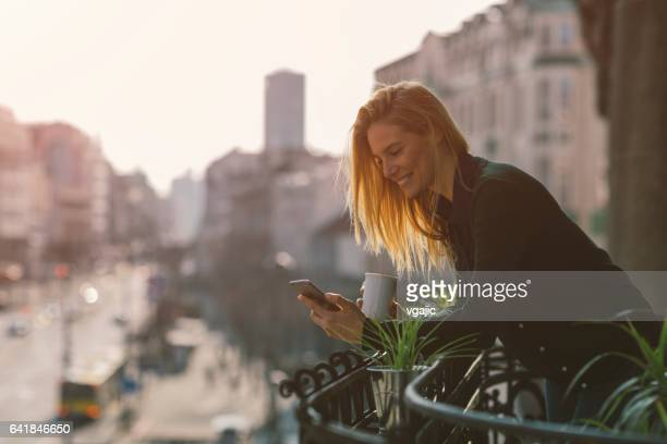 Single woman on hotel balcony