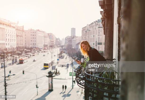 single woman on hotel balcony - balcony stock pictures, royalty-free photos & images