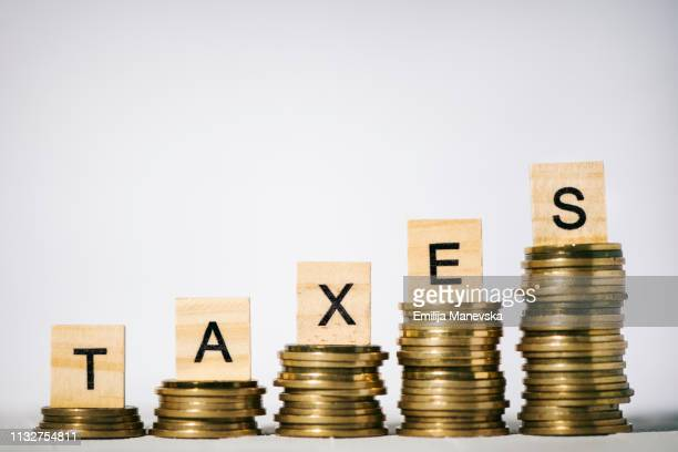 single word taxes on wooden block - the_writer's_block stock pictures, royalty-free photos & images