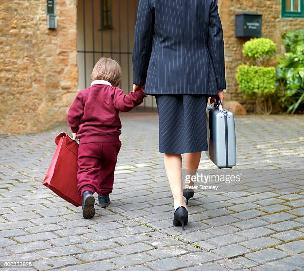 single working mother taking child to school - uniform stock pictures, royalty-free photos & images
