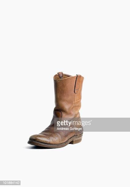 a single worn cowboy boot - カウボーイブーツ ストックフォトと画像