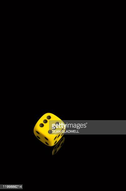single yellow dice - yellow stock pictures, royalty-free photos & images