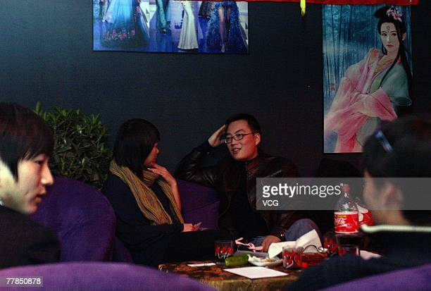 Single young people attend a blind date at a bar as part of 'Singles Day' on November 11 2007 in Beijing China Since its origination in Nanjing as a...