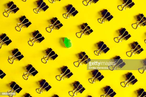 singled out. binder clips and green jelly bean frog - clip stock pictures, royalty-free photos & images