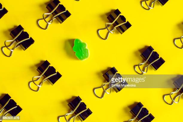 Singled Out. Binder clips and green jelly bean frog