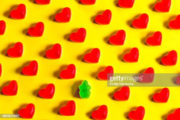 Singled Out. Heart shaped jelly bean and green frog