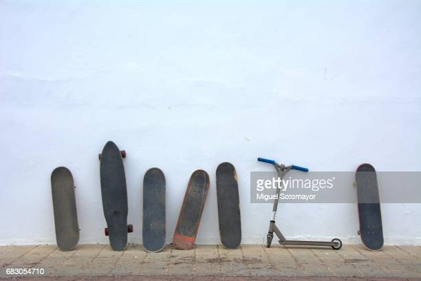 singled out. one scooter in a skateboarding world - different cultures stock pictures, royalty-free photos & images