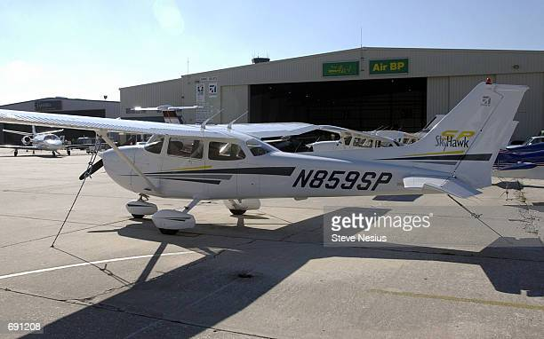A singleengine Cessna aircraft sits on the tarmac outside a hangar January 8 2002 at the St PetersburgClearwater Airport International Airport used...