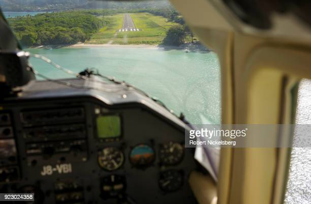 A singleengine plane flown by SVG Air flies approaches the runway February 2 2018 of the island of Carriacou Grenada Carriacou is one of three...