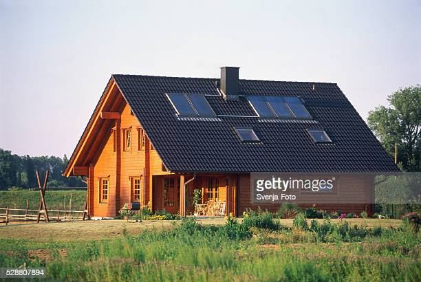 Single-family house with solar panel on the roof