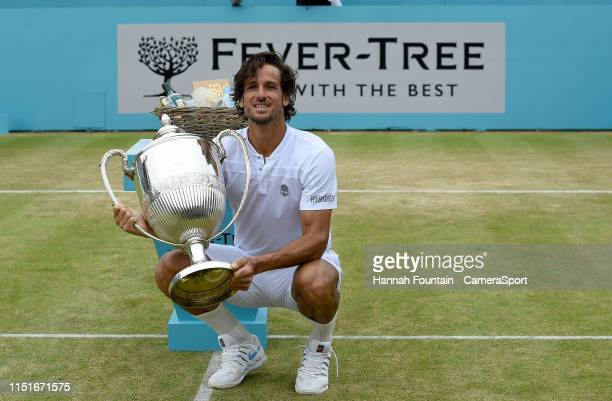 Singles Champion Feliciano Lopez with the champions trophy after beating Gilles Simon in the final during day 7 of the FeverTree Championships at...