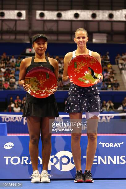 Singles champion Karolina Pliskova of the Czech Republic and runnerup Naomi Osaka of Japan pose for photographs with the trophies after the Singles...