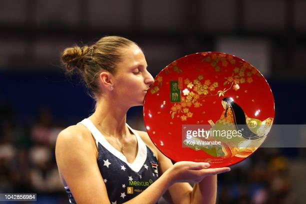 Singles champion Karolina Pliskova of the Czech Republic kisses the trophy after the Singles final against Naomi Osaka of Japan on day seven of the...