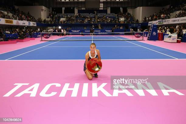 Singles champion Karolina Pliskova of the Czech Republic poses for photographs with the trophy after the Singles final against Naomi Osaka of Japan...