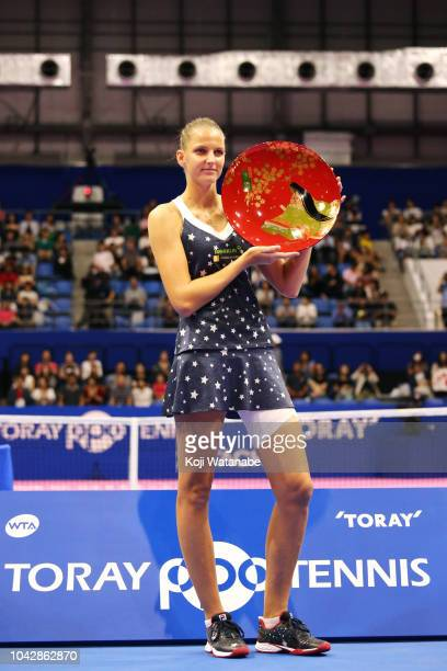 Singles champion Karolina Pliskova of the Czech Republic poses with the trophy after the Singles final against Naomi Osaka of Japan on day seven of...