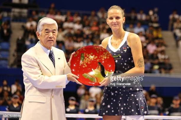 Singles champion Karolina Pliskova of the Czech Republic receives the trophy after the Singles final against Naomi Osaka of Japan on day seven of the...