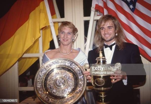 Singles Champions Andre Agassi of the USA and Steffi Graf of Germany pose with their trophies at the Wimbledon Champions' Dinner on July 5 1992 in...