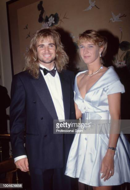 Singles Champions Andre Agassi of the USA and Steffi Graf of Germany pose together at the Wimbledon Champions' Dinner on July 5 1992 in London England