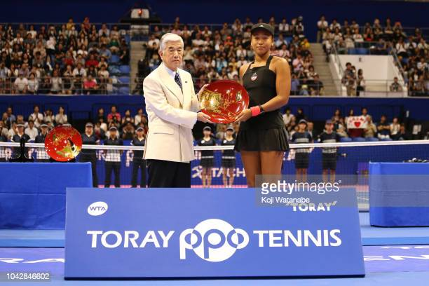 Singles runnerup Naomi Osaka of Japan poses for photographs with the trophy after the Singles final on day seven of the Toray Pan Pacific Open at...
