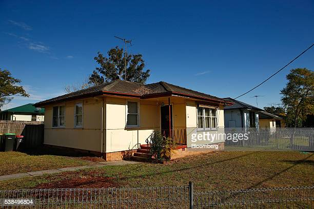 Singlestorey houses stand in the western suburb of Penrith in Sydney Australia on Monday June 6 2016 An economic divide is almost slicing Sydney in...