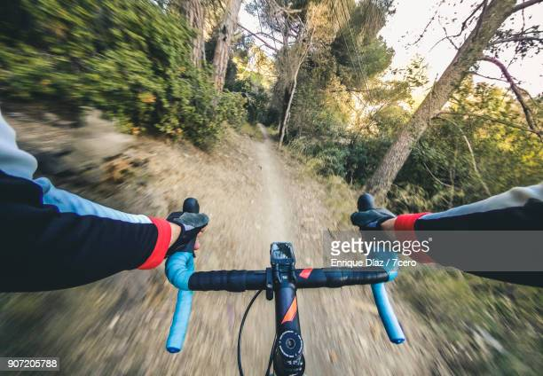 singletrack ride, blue handlebars - handlebar stock photos and pictures