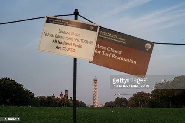 Sings indicate that the National Mall is closed both for turf restoration and because of a government shutdown October 3 2013 in Washington DC The...