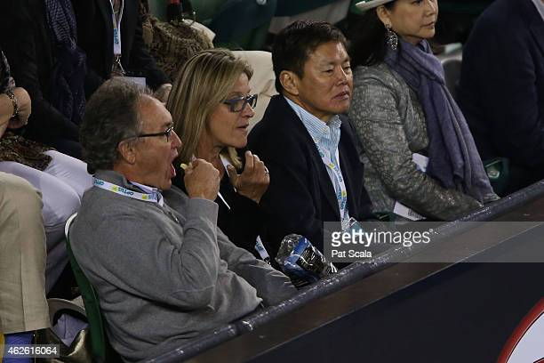 SingTelOptus CEO Allen Lew watches the action at Rod Laver Arena during day 14 of the 2015 Australian Open at Melbourne Park on February 1 2015 in...