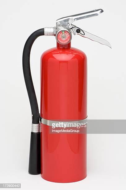 A singular red fire extinguisher