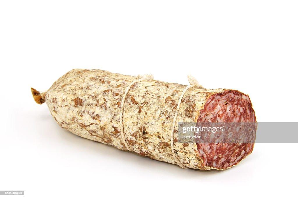 A singular salami sausage on white : Stock Photo